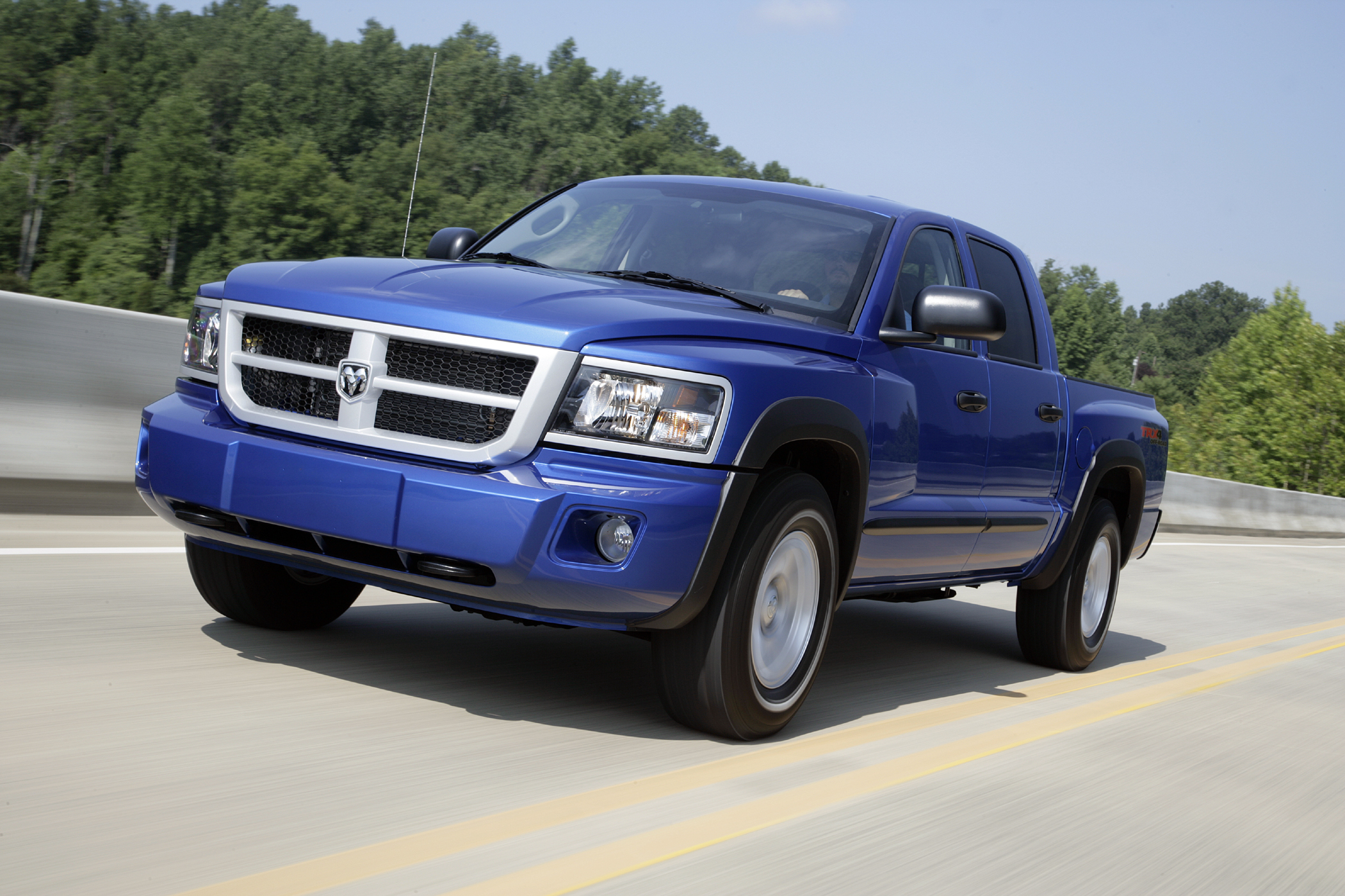 Manufacturer photo: Dodge's 2010 Dakota TRX4 4x4 crew-cab pickup is off-road