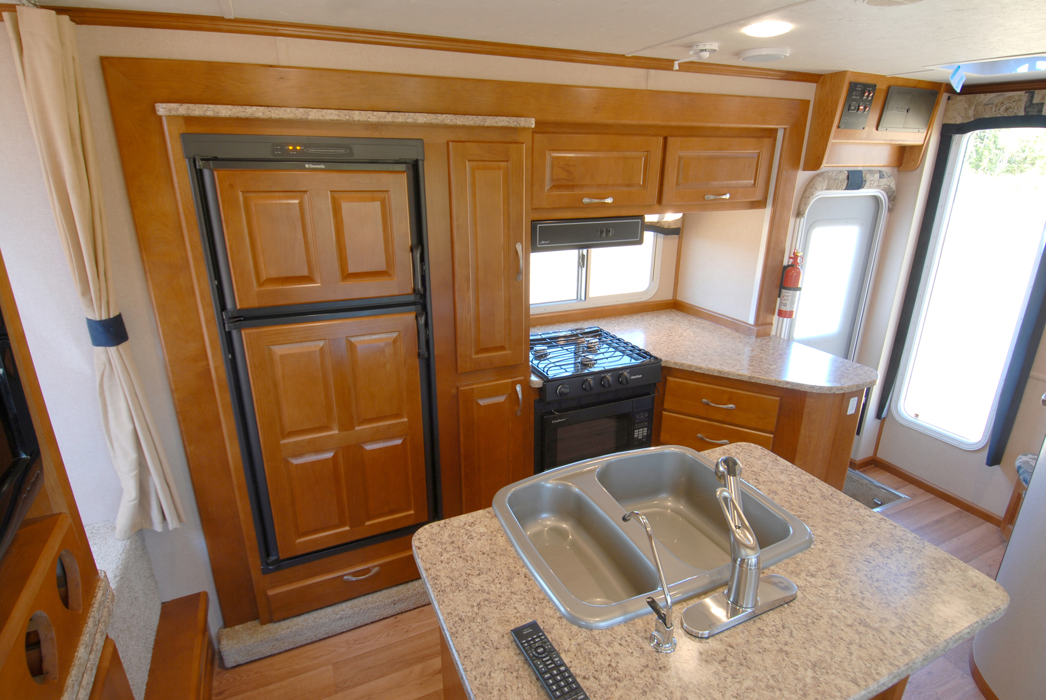 Home away from home rv camper with island kitchen for Home away from home cabins