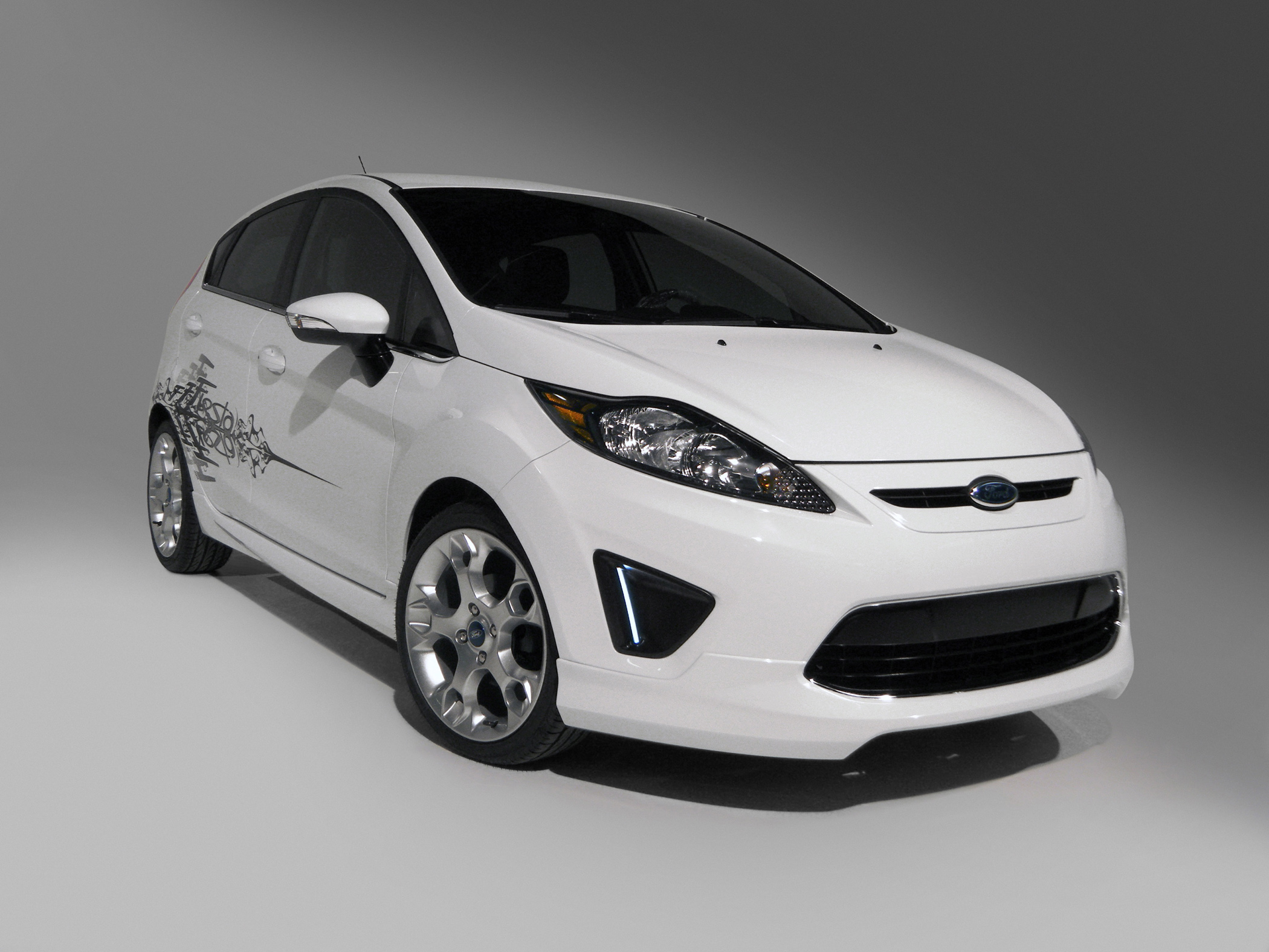 Manufacturer photo: The 2011 Ford Fiesta offers buyers an extensive range of vibrant color options called Lime Squeeze, Yellow Blaze -- even ordinary, yet popular colors, such as Oxford White.