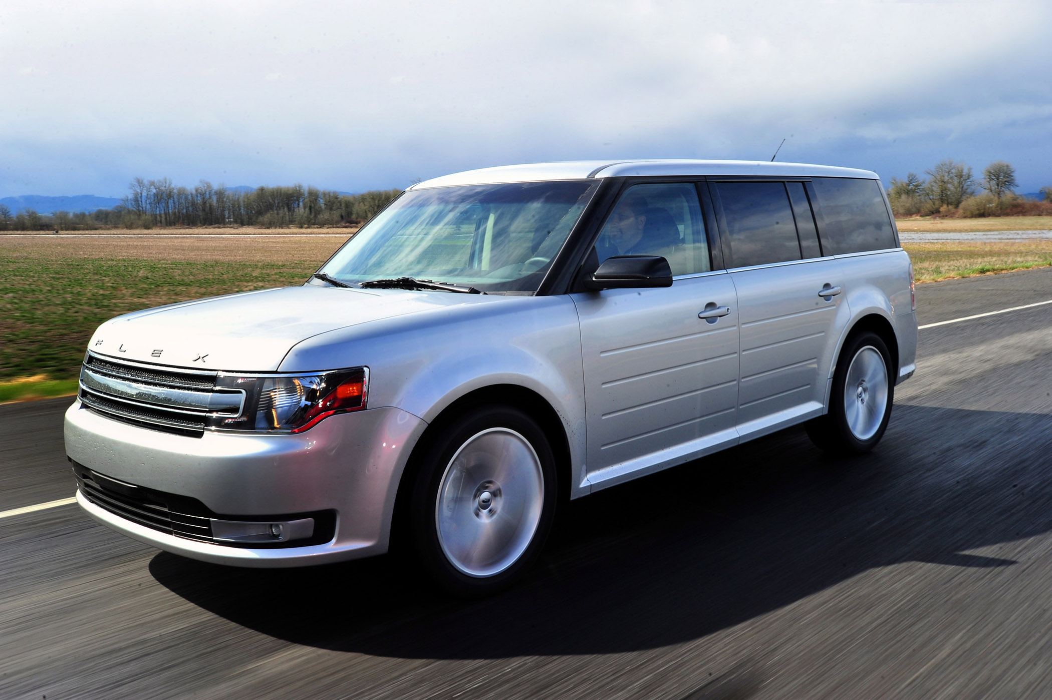Manufacturer photo: The new three-row, seven-passenger 2013 Ford Flex offers comfort and advanced technology in a distinctive package, including a sleek new front end, modern interior and six all-new wheel styles