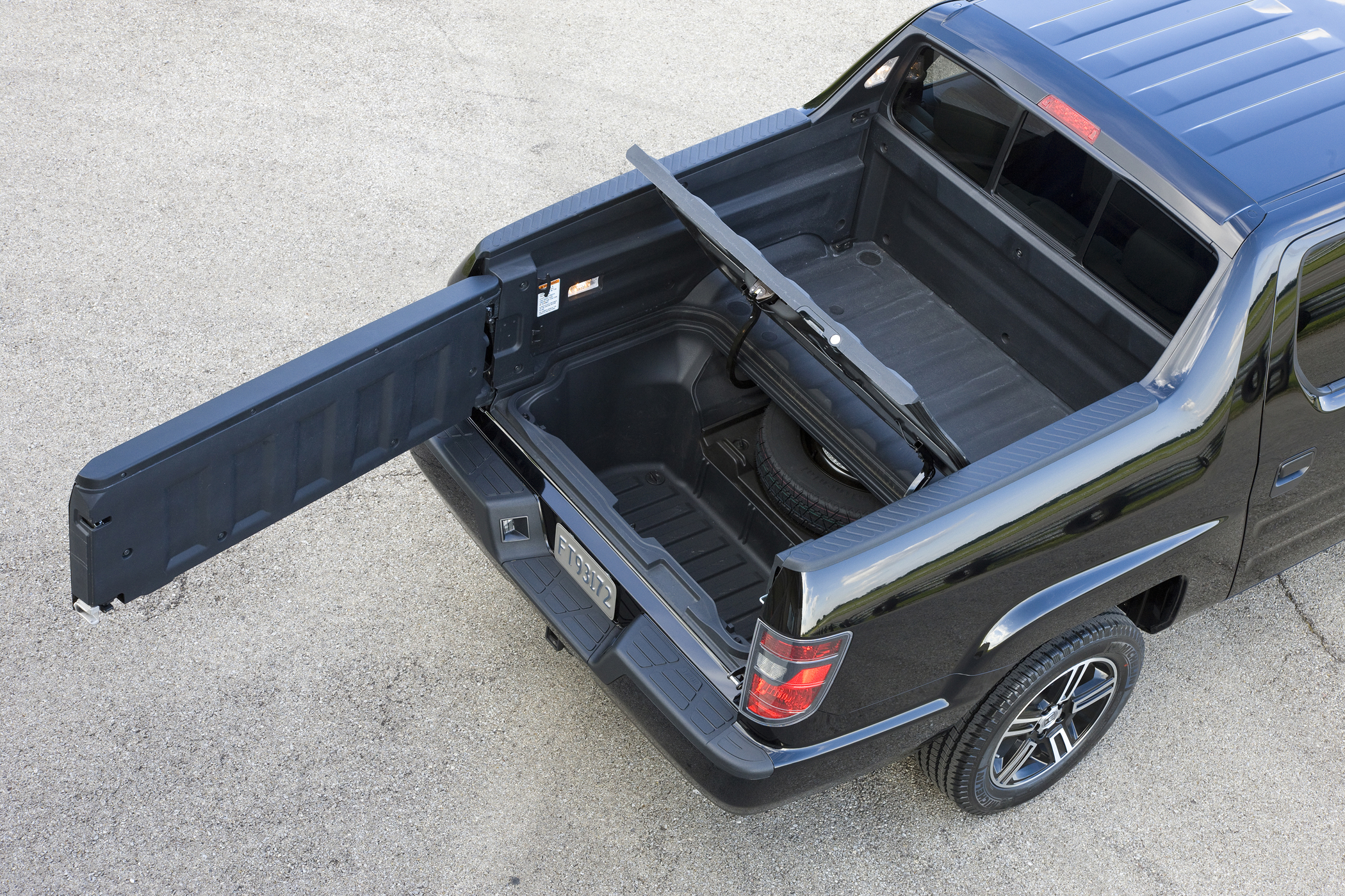 Honda Adds Sport Pickup To 2012 Ridgeline Lineup Truck Talk Trailer Hitch Wiring The Dashboard And Center Console Are Practical Utilitarian Designs Speedometer Is Large Mounted Easy Read Climate Control Radio