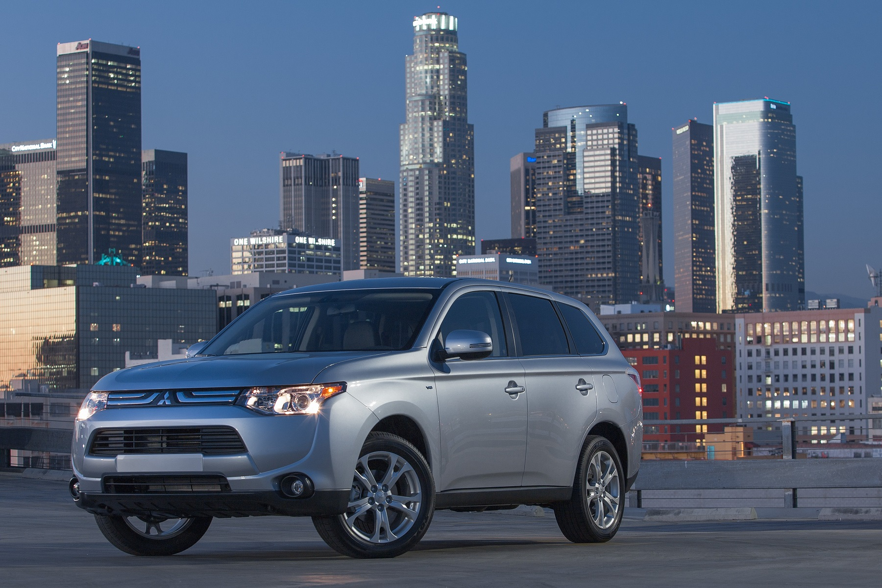 Manufacturer photo: With new styling inside and out, a new engine equipped with next-generation MIVEC variable valve-timing, technologically-advanced safety features and a lightweight, aerodynamically-enhanced body, the new 2014 Mitsubishi Outlander is sure to be one of the most fuel-efficient compact CUVs with standard 7-passenger seating available to automotive consumers in North America