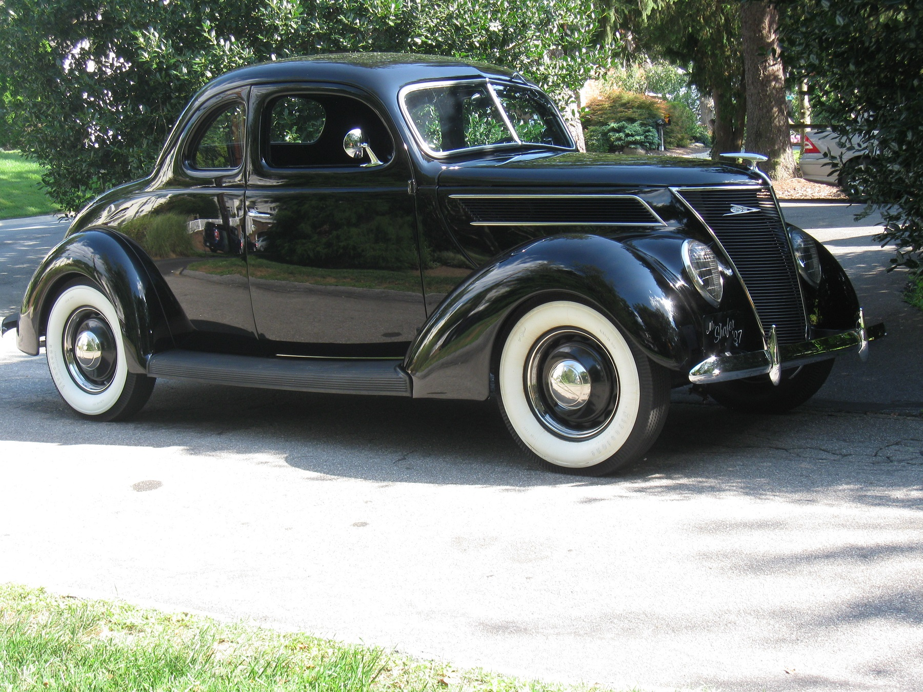 man feels at home in 1937 ford standard coupe