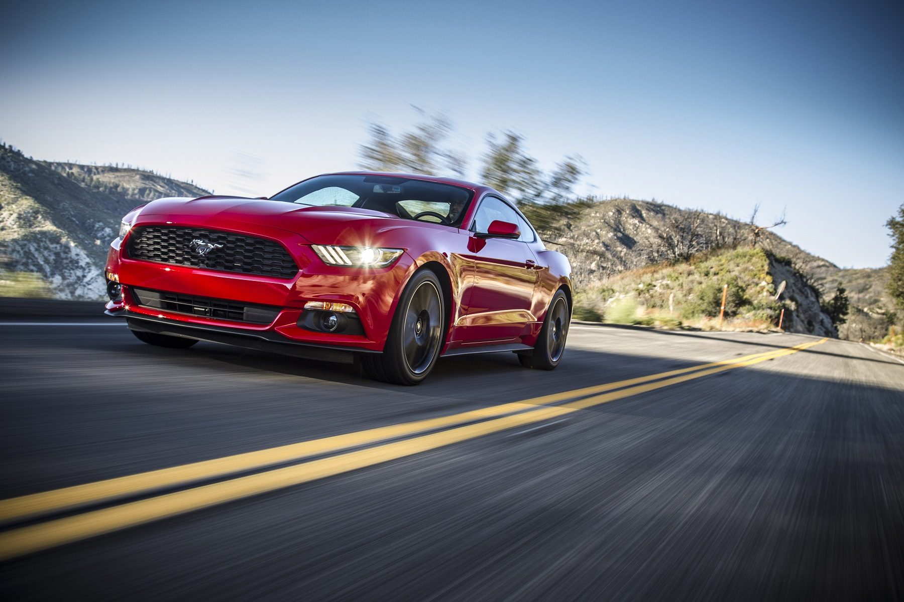Manufacturer photo: The clean-sheet design of the 2015 Mustang fastback and convertible evokes the essential character of the brand, retaining key design elements -- including the long sculpted hood and short rear deck -- with contemporary execution