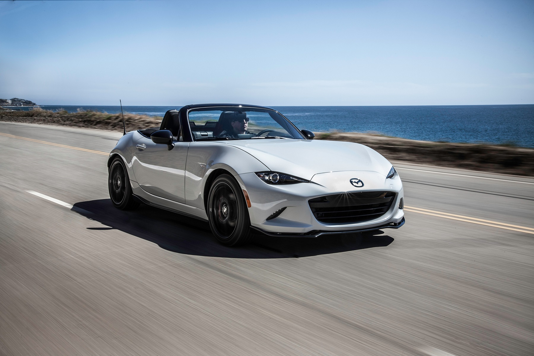Manufacturer photo: Lightweight, nimble and fun to drive, the fourth-generation 2016 Mazda MX-5 draws inspiration from MX-5s that came before it, pairing the driver as one with the car