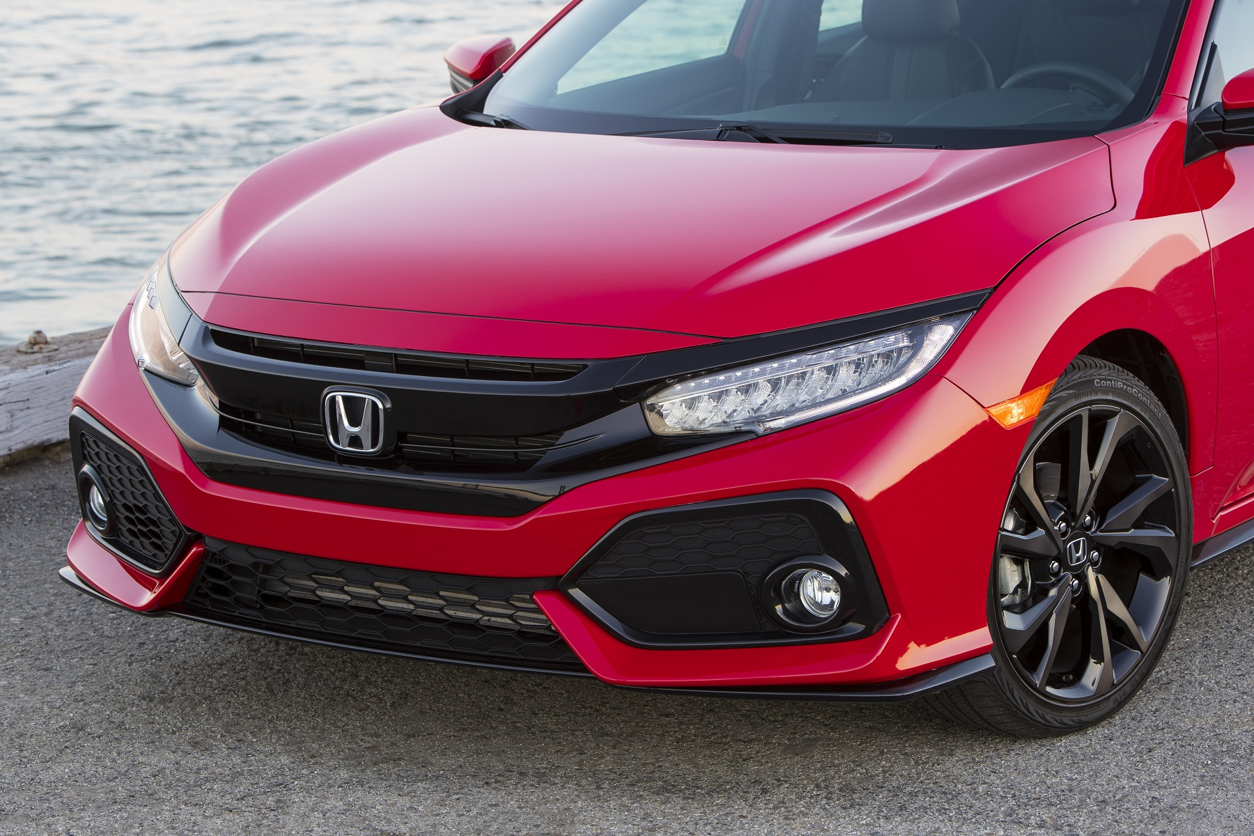 Manufacturer photo: The 2017 Honda Civic Hatchback combines striking, Euro-inspired styling and five-door versatility with the Civic's world-class driving dynamics and Honda direct-injected turbo engine technology