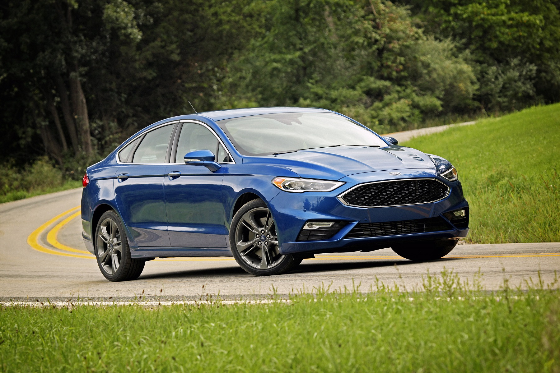 Distinguishing its outward appearance are revised front styling with larger air intakes and a gloss-black mesh grille to inform left-lane hogs this is the ...