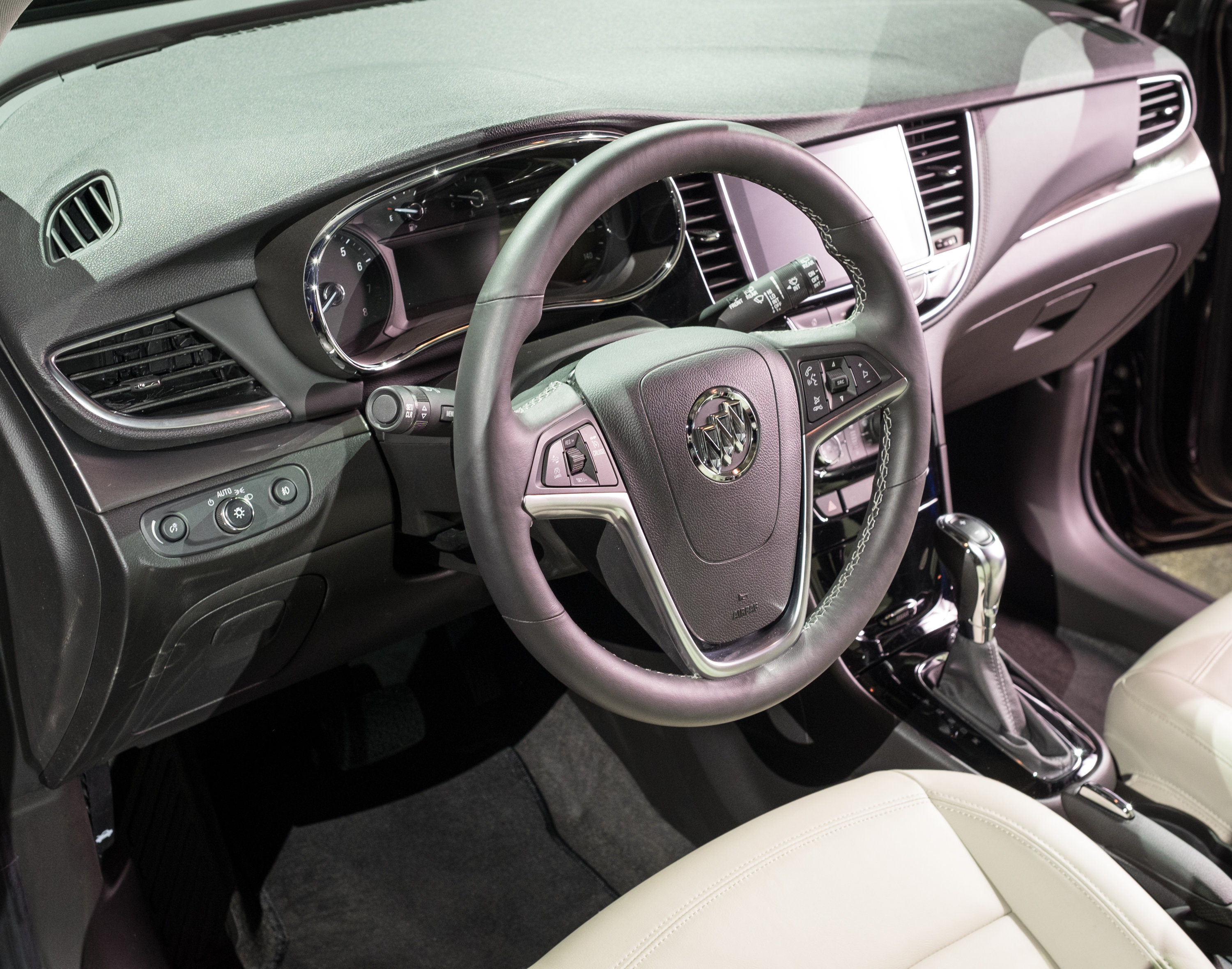 Manufacturer photo: A new front-end appearance and a new premium interior highlight the visual refinements on the 2017 Buick Encore, while Apple CarPlay and Android Auto are supported by a next-generation IntelliLink system