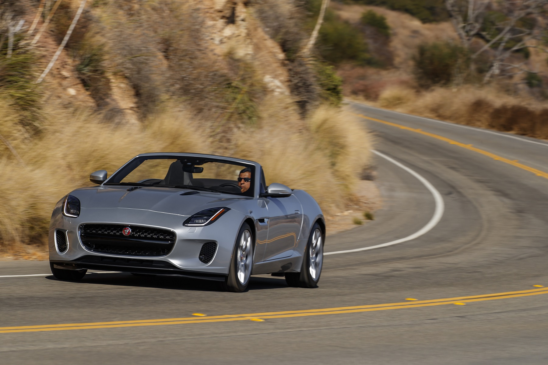 Manufacturer photo: The 2018 F-Type exhibits a near-perfect proportion and stance, with a long hood, a rearward-positioned cabin, and a short rear deck and overhang