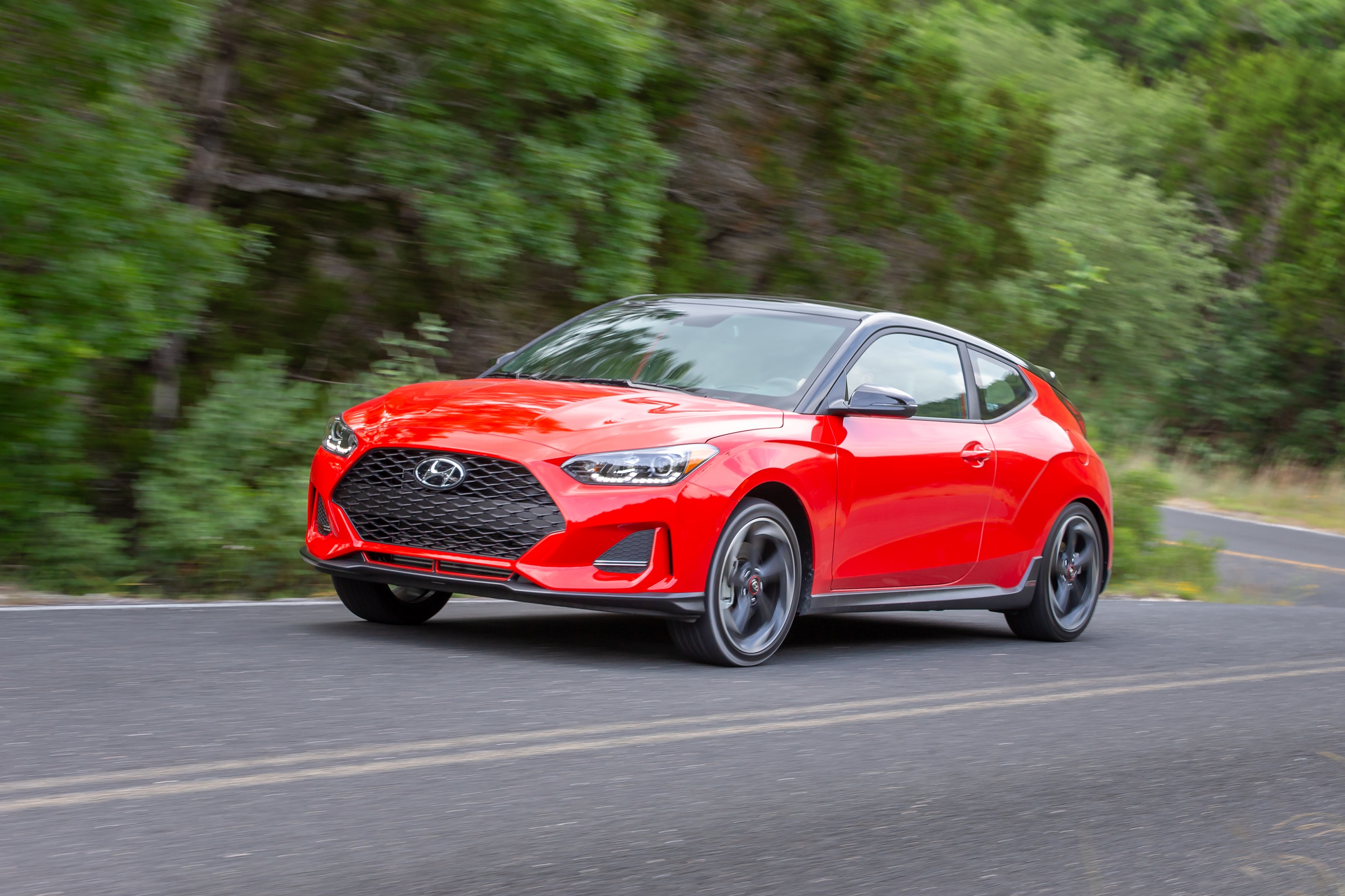 Manufacturer photo: The Veloster merges the design appeal of a sport coupe with the versatility of an additional passenger side rear door in an asymmetrical two-plus-one configuration for easier rear-seat access