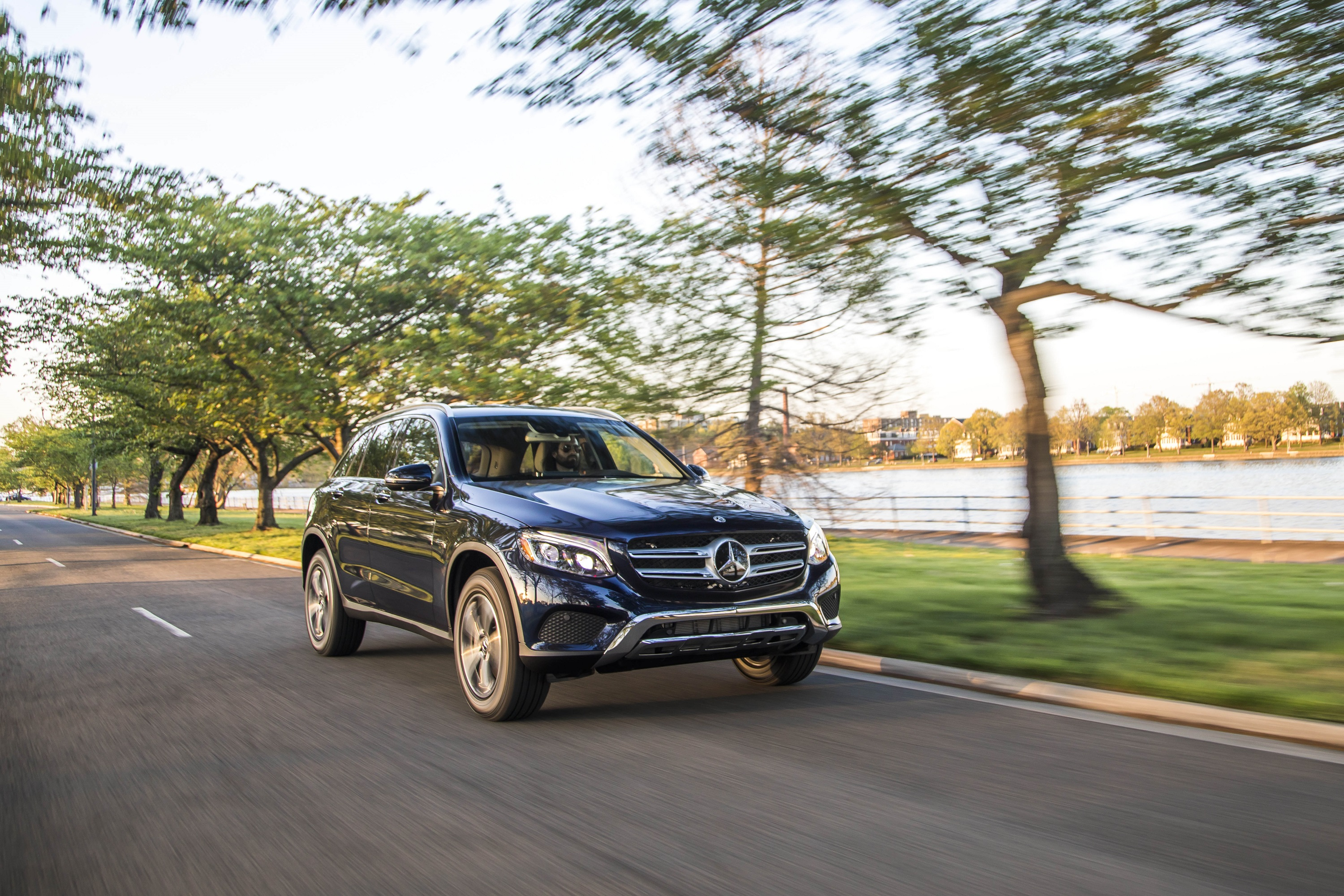 "Manufacturer photo: The 2019 GLC 350e wears a coupe-like body style that leads off with a bold, expressive front end featuring a horizontal two-bar grille anchored by a large, circular three-pointed star logo and flanked by ""cat's-eye"" headlamps"