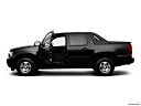2009 Chevrolet Avalanche LS, driver's side profile with drivers side door open.