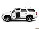 2010 Chevrolet Tahoe LTZ, driver's side profile with drivers side door open.