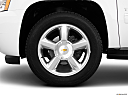2010 Chevrolet Tahoe LTZ, front drivers side wheel at profile.