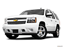 2010 Chevrolet Tahoe LTZ, front angle view, low wide perspective.