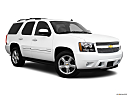 2010 Chevrolet Tahoe LTZ, front passenger 3/4 w/ wheels turned.