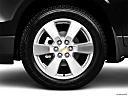 2010 Chevrolet Traverse LTZ, front drivers side wheel at profile.
