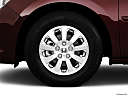2010 Honda Odyssey EX, front drivers side wheel at profile.