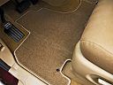 2010 Honda Odyssey EX, driver's floor mat and pedals. mid-seat level from outside looking in.