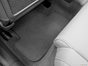 2011 Audi A4 2.0T, rear driver's side floor mat. mid-seat level from outside looking in.