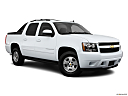 2011 Chevrolet Avalanche LS, front passenger 3/4 w/ wheels turned.