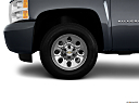 2011 Chevrolet Silverado 1500 WT, front drivers side wheel at profile.