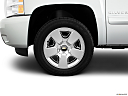 2011 Chevrolet Silverado 1500 LT, front drivers side wheel at profile.