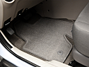 2011 Ford Escape XLS I4, driver's floor mat and pedals. mid-seat level from outside looking in.