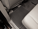 2011 Ford Expedition XLT, rear driver's side floor mat. mid-seat level from outside looking in.