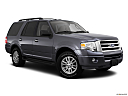 2011 Ford Expedition XLT, front passenger 3/4 w/ wheels turned.