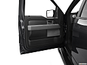 2011 Ford F-150 XLT, inside of driver's side open door, window open.