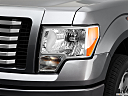 2011 Ford F-150 XLT, drivers side headlight.