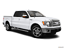 2011 Ford F-150 Lariat, front passenger 3/4 w/ wheels turned.