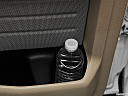 2011 Ford F-150 Lariat, second row side cup holder with coffee prop, or second row door cup holder with water bottle.