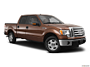 2011 Ford F-150 XLT, front passenger 3/4 w/ wheels turned.