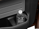 2011 Ford F-150 XLT, second row side cup holder with coffee prop, or second row door cup holder with water bottle.