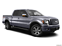 2011 Ford F-150 FX4, front passenger 3/4 w/ wheels turned.