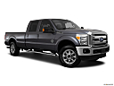 2011 Ford F-250 SD Lariat, front passenger 3/4 w/ wheels turned.