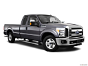 2011 Ford F-250 SD XLT, front passenger 3/4 w/ wheels turned.