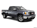 2011 GMC Sierra 1500 SLE, front passenger 3/4 w/ wheels turned.