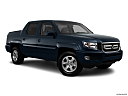 2011 Honda Ridgeline RTS, front passenger 3/4 w/ wheels turned.