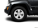 2011 Jeep Liberty Sport, front drivers side wheel at profile.