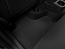 2011 Jeep Liberty Sport, rear driver's side floor mat. mid-seat level from outside looking in.