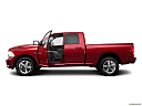 2011 Ram Trucks Ram 1500 Sport Quad, driver's side profile with drivers side door open.