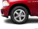 2011 Ram Trucks Ram 1500 Sport Quad, front drivers side wheel at profile.