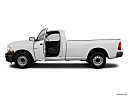 2011 Ram Trucks Ram 1500 ST, driver's side profile with drivers side door open.