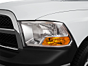 2011 Ram Trucks Ram 1500 ST, drivers side headlight.