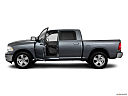 2011 Ram Trucks Ram 1500 SLT, driver's side profile with drivers side door open.