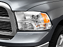 2011 Ram Trucks Ram 1500 SLT, drivers side headlight.