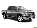 2011 Ram Trucks Ram 1500 SLT, front passenger 3/4 w/ wheels turned.